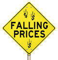 Falling prices reduced slashing costs special sale discount the words and dollar signs or symbols on a yellow warning sign to Royalty Free Stock Image