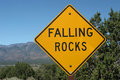 Falling rocks ahead road sign Stock Photography