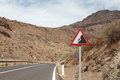 Falling rocks sign on a road in spain Royalty Free Stock Photo