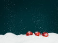 Falling snow and christmas globes Royalty Free Stock Photo