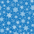 Falling snowflakes seamless pattern background vector with drawn on light blue Stock Images