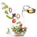 Falling vegetables and oil isolated Stock Photo