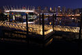 False creek night cityscape a dock and ramp on vancouver s at with the city skyline and sports stadiums in the background british Royalty Free Stock Photo