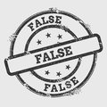 FALSE rubber stamp isolated on white background.