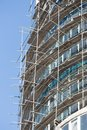 Falsework on a facade of the under construction house. Royalty Free Stock Photo