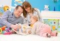 Família feliz que joga junto Foto de Stock Royalty Free