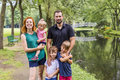 Families with children close to a waterscape Royalty Free Stock Photo