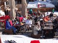 Families enjoy eating outdoors avoriaz france mar during the french school holiday week on mar in avoriaz france Stock Photo