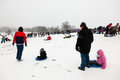 Families enjoying sledding in the snowy weather on Parliament Hi Royalty Free Stock Photography