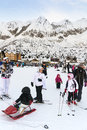 Families on holiday on the slopes of the Italian Alps. Royalty Free Stock Photo