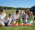 Families picnic outdoors