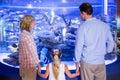 Familly looking at fish tank the aquarium Royalty Free Stock Photography