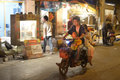 Familly on mopped parents with young boy passing travel old in poor part of changning district old shops in backgroung panning Royalty Free Stock Photo