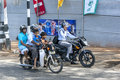 A family aboard a motor bike in kandy in sri lanka it is common four or people to ride on one motorbike Stock Image