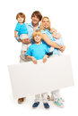 Family and advertising beautiful with three kids two boys little girl holding blank advertisement banner Stock Photos