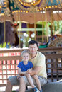 Family at amusement park happy smiling son and his handsome father spending fun time together Stock Photos
