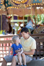 Family at amusement park of young father and his happy son the Stock Image