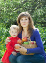 Family with apples harvest in garden Royalty Free Stock Photos