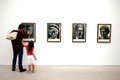 Family in art exhibition at the saatchi gallery father and his daughter view artworks gallerys paper london Royalty Free Stock Photography