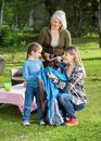 Family assembling tent at campsite happy three generation females Stock Photography