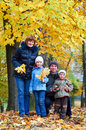 Family in autumn park Royalty Free Stock Images