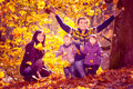 Family in the autumn park portrait of a young Stock Images