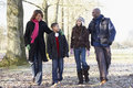 Family On Autumn Walk In Countryside Royalty Free Stock Photos