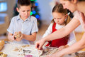 Family baking christmas cookies at home Royalty Free Stock Photography