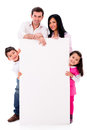 Family with a banner happy isolated over white background Stock Photography