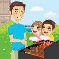 Family barbecue party father grilling meat and hungry children holding empty dishes wanting to eat together in Royalty Free Stock Images