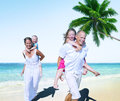 Family beach enjoyment holiday summer concept Royalty Free Stock Images