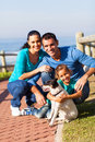 Family beach pet happy at the with dog Stock Images