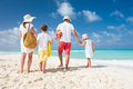 Family beach vacation back view of a happy on tropical Royalty Free Stock Photography