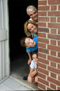 Family behind the wall Royalty Free Stock Photo