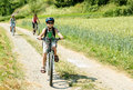 Family on bicycle trip teenager riding in sunny day Royalty Free Stock Photography