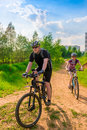 Family on bike exercising on a country road Royalty Free Stock Photo