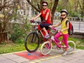 Family bike ride. Family wearing bicycle helmet with rucksack. Royalty Free Stock Photo
