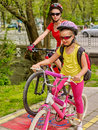 Family bike ride. Family wearing bicycle helmet with rucksack . Royalty Free Stock Photo