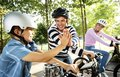 Image : Family on a bike ride in the park a