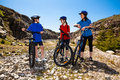 Family biking active mother and kids Stock Images