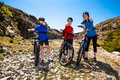 Family biking active mother and kids Royalty Free Stock Image