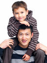 Family bonding - Son on his fathers shoulders Royalty Free Stock Photo