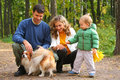 Family with boy and dog in wood Stock Images