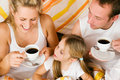 Family breakfasting in bed Royalty Free Stock Images