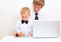 Family in business style working at home father and son with laptop and touch pad Royalty Free Stock Photos