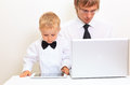 Family in business style working at home father and son with laptop and touch pad Royalty Free Stock Images
