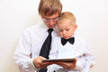 Family in business style working at home father and son with touch pad Stock Photography