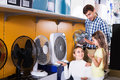 Family buying fan blower Royalty Free Stock Photo
