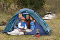 Family camping in tent Royalty Free Stock Image