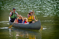 Family Canoeing at Lake Royalty Free Stock Photo